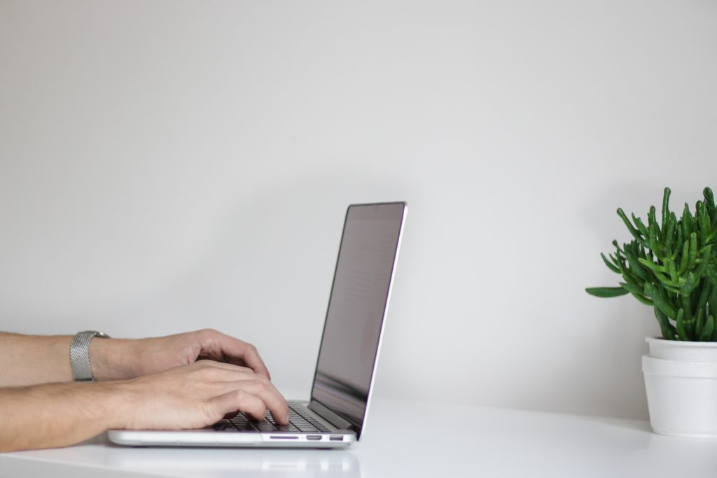 Man with laptop on desk