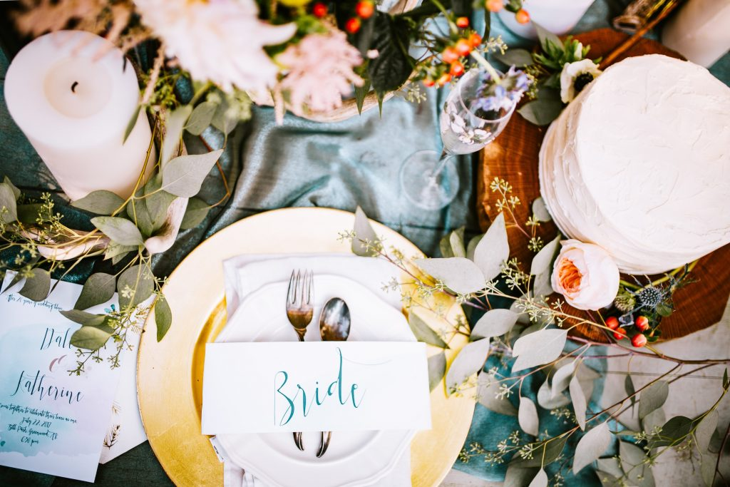Flowers, place settings and tableware at a wedding reception