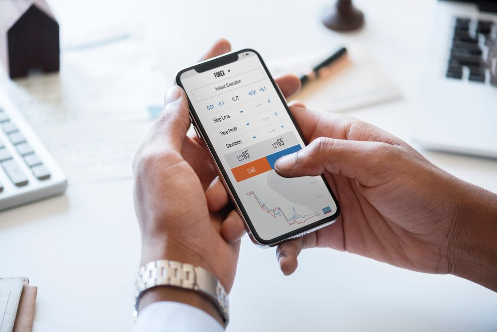 Managing finances at desk on mobile phone