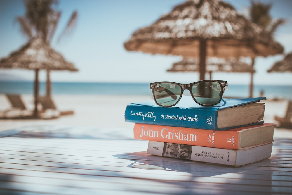 books and sunglasses