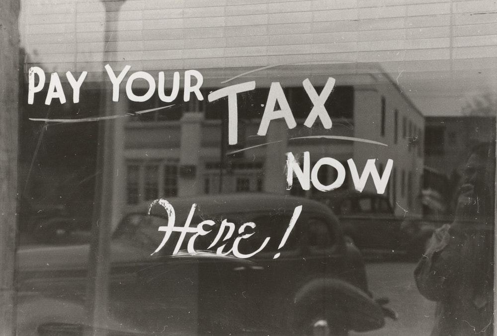 tax slogan written on shop window